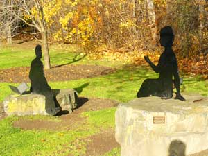 Silhouettes of Robert Frost and Emily Dickinson on Main Street in Amherst -  photos by Stephen Hartshorne