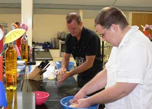 Chef Nick Martin shows Sam how it's done during our class at Lucy Cooks.