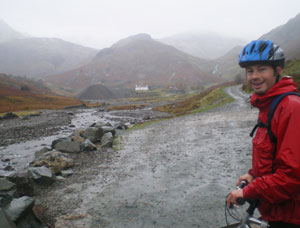 Johan Hoving in front of Coniston's former copper mill, atop a hill we climbed on mountain bikes. He said some US guests are weather wimps. Not us!