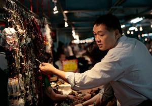 Vendor in the Jade market. Paul Shoul photo.