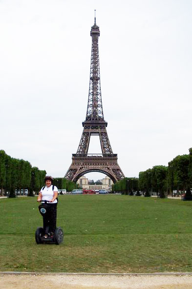 The author poses in fron of the Eiffel Tower on her Segway.