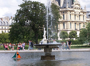 Tuileries fountain in front of the Louvre with children's sailboat