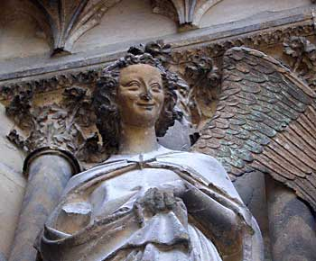The Smiling Angel in the Notre-Dame de l'Epine basilica in Reims. Photos by Kent St. John.