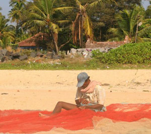 A fisherman mending his nets