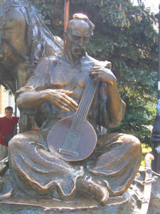 A statue of a cossack playing a pandora, a Ukrainian stringed instrument