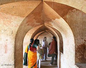 Listening to the guide, inside the Labyrinth, Bara Imambara, Lucknow - photos by Mridula Dwivedi