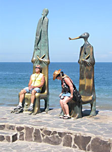 The sculptures on the Rotunda of the Sea serve as a rest stop along The Malecon.