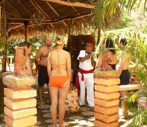 Standing in front of Abuelo Fuego (Grandfather Fire) as part of the traditional Aztec Temazcal Ritual