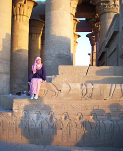 Most Egyptian women wear artfully draped headscarves. This girl poses on a temple wall at Luxor.