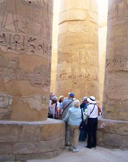 The 134 carved columns in Karnak's mammoth Hypostyle Hall dwarf mere humans who come to admire them.