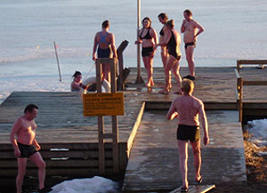 A group from the sauna makes its way down the dock