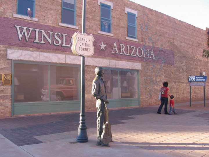 Statue in Winslow, Arizona made famous by the Eagles. There is a flatbed Ford and a lifesize statue of Jackson Browne at this famous corner in Winslow. Shady Hartshorne photo.