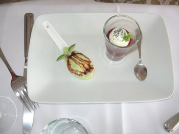 Coquille St. Jacques foamed in a single serving spoon with a shooter of farm cheese floating on a puree of sweet beet mousse