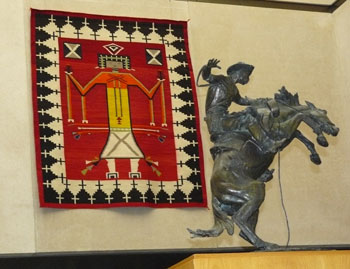 A statue by Frederic Remington and a Navajo blanket at the Stark Museum of Art in Orange, Texas