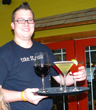 Our waiter Fox with my very first pomegranate martini at Easy's in Beaumont