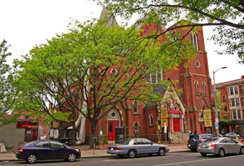 Yale Repertory Theatre with its brightly painted red doors. The Italian restaurant Scoozzi can be seen on the left hand side of the picture.