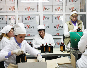 Checking and boxing bottles of Kvint