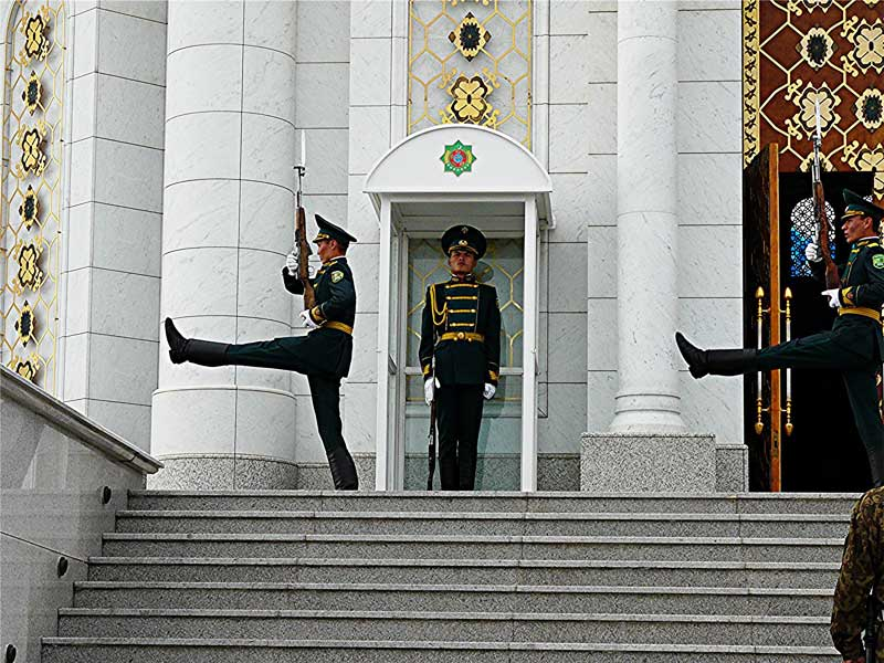 Guards goosestep at the mausoleum of the late President Saparmurat Niyozov in Ashgabat, Turkmenistan