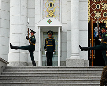 Guards goosestep at the mausoleum of the late President Saparmurat Niyozov - photo by David Rich.