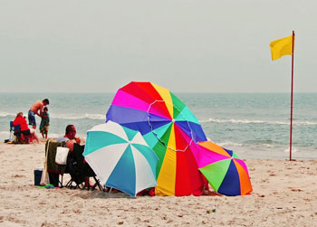 Colorful umbrellas dotted the Assateague Island shoreline