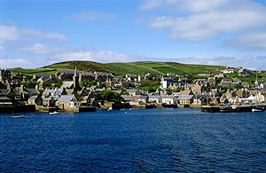 Stromness is a picturesque harbor town of 1,200. Note the rich green of the fields out of town. During midsummer the farmers take advantage of the days' length, fertilizing with good old-fashioned silage. The strong crosswinds plastered the scent into our clothes during our day of cycling into pre-history. Photo courtesy of visitorkney.com