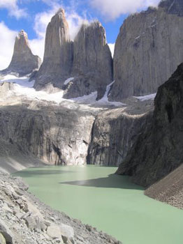 The three Torres del Paine rise above glacier melt water.