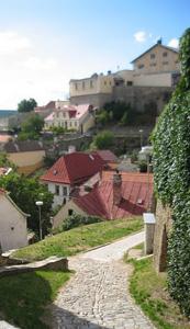 Terra cotta roofs hug the hillside.
