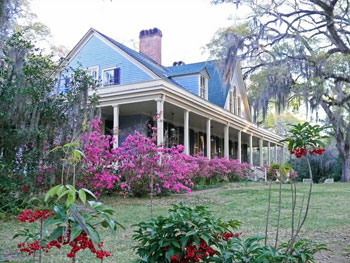 Spanish moss and blooming shrubs soften and hush the front porch of the Butler Greenwood plantation home. Photo by Henry Cancienne.
