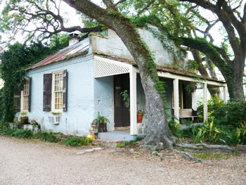 In the 1800s, when most of St. Francisville's plantations were built, kitchens were deemed too dangerous to house inside the main home. This old kitchen is still standing on the grounds of the Butler Greenwood Plantation. Today it is a B&B cottage. Photo by Henry Cancienne.