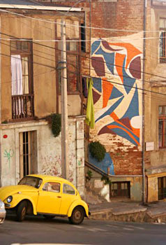 One of the 20 murals that are part of the Museo a Cielo Abierto brightens up a wall along Subida Ferrari.