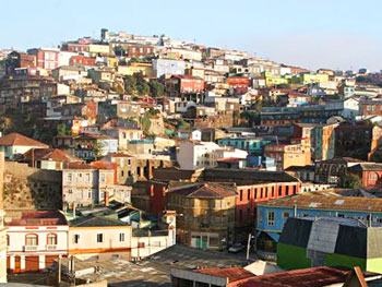 Ramshackle houses and colonial architecture fight for space on the steep hillside of Cerro Cordillera.