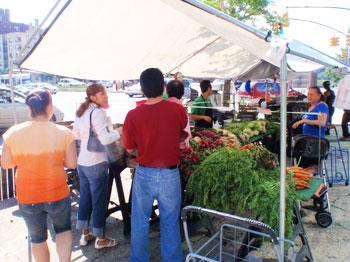 A sidewalk produce stand
