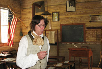 The Schoolteacher in Old Alabama Town will tell you all about how he conducts his classes.