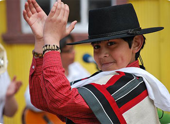 A little boy takes pride in dancing the Cueca.