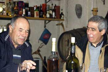Fordongianus' mayor (left) and historian Mario Zedda in Pietro's cave