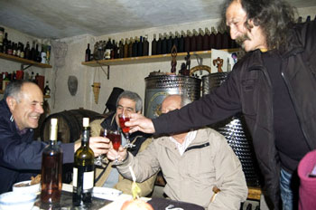 My friend Pietro (right) making a toast with Fordongianus' mayor (left) and historian Mario Zedda in Pietro's cave