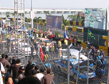 Drivers wait on the grid for an accident to be cleared.