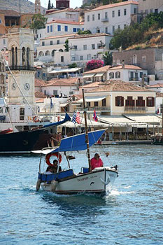 Houses rise above the harbor in Hydra.