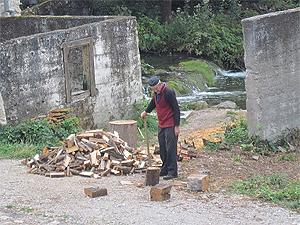 Chopping wood in Rastoke, Croatia.