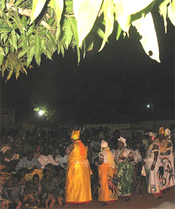 Voodooshi and Chief's spouses arrive at a family's Voodoo Ceremony in Benin.