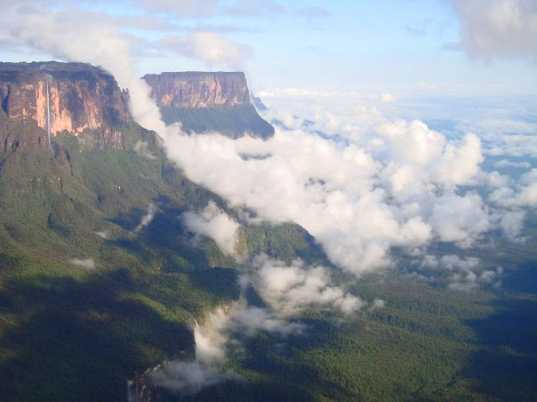Roraima and Kukenaam rise above the rainforests of Guyana at the triple border with Brazil and Venezuela. Photo by David Joshua Jennings.
