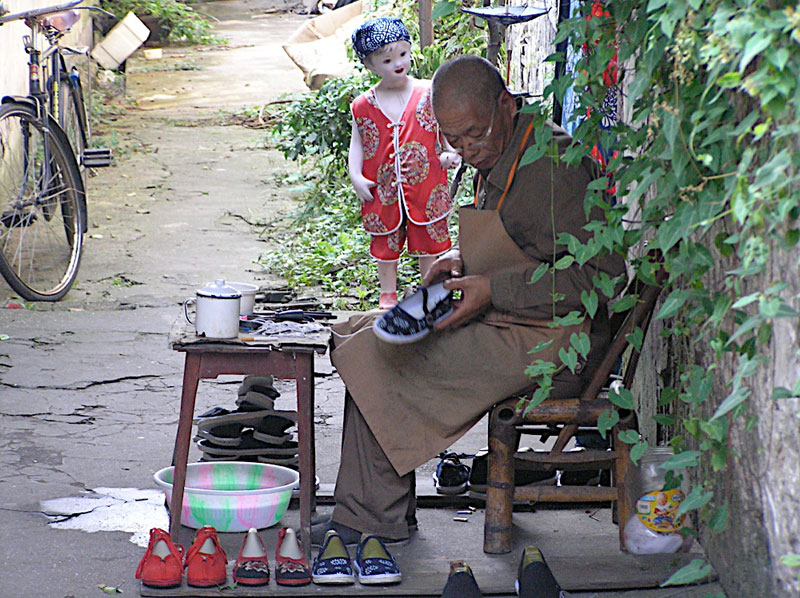 A traditional shoemaker at work in Wuzhen, China