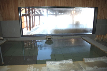 Inside the onsen, or Japanese bath, with snow outside.