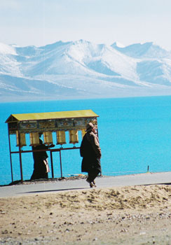Prayer wheels on the shore of Lake Namtso