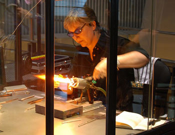 A flameworking demonstration at the Corning Museum of Glass. Plain glass rods were transformed into a miniature fox right in front of our eyes. Photos by Pinaki Charkaborty.