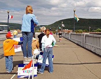 The Wineglass Marathon 2009 in full swing on the Pedestrian Bridge stretching across the Chemung River of New York.