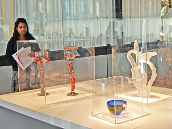 """Author admiring the """"Voices of Contemporary Glass: The Heineman Collection"""" in the upper level Gallery."""