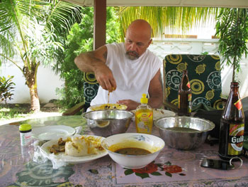 Eating traditional Ghanaian fare like the locals - with your hands. Notice the water bowl and soap for cleaning up those sticky fingers later.