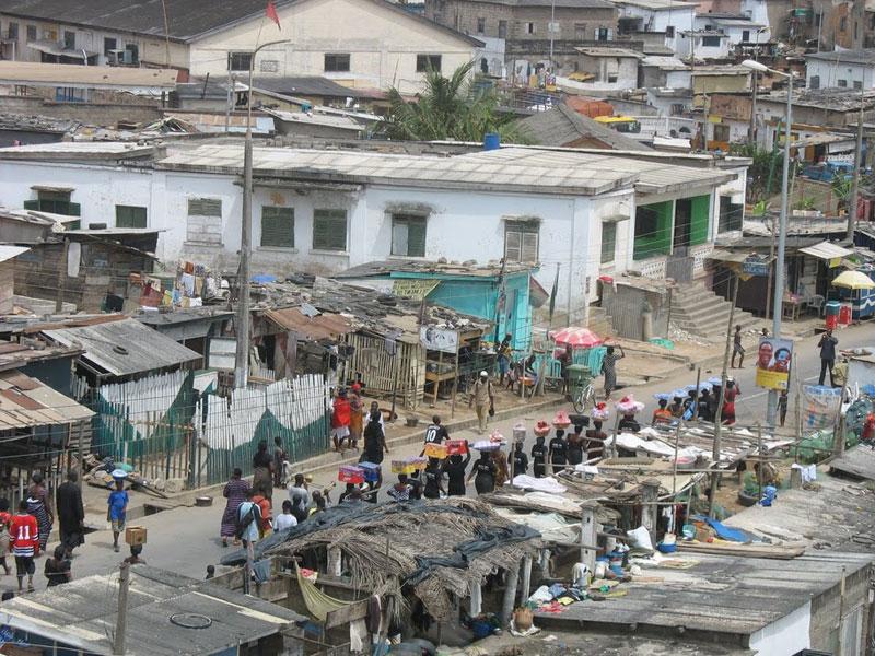 Bringing wares to market in Cape Coast, Ghana