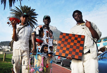Camps Bay beach offers some alternative shopping options: Samuel Kalule, Peter Kanyerere and friend show off their crafts.